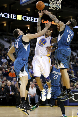 OAKLAND, CA - DECEMBER 14:  Nikola Pekovic #14 and Michael Beasley #8 of the Minnesota Timberwolves defend against Monta Ellis #8 of the Golden State Warriors at Oracle Arena on December 14, 2010 in Oakland, California.  NOTE TO USER: User expressly ackno