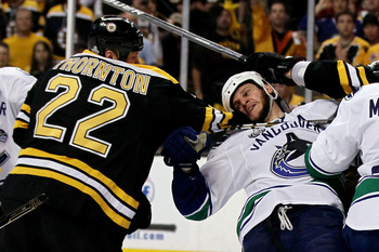 BOSTON, MA - JUNE 13:  Shawn Thornton #22 of the Boston Bruins fights with Kevin Bieksa #3 of the Vancouver Canucks during Game Six of the 2011 NHL Stanley Cup Final at TD Garden on June 13, 2011 in Boston, Massachusetts.  (Photo by Elsa/Getty Images)