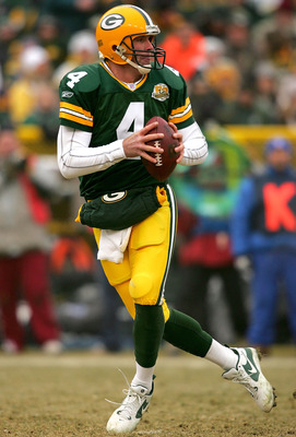 GREEN BAY, WI - DECEMBER 30:  Quarterback Brett Favre #4 of the Green Bay Packers fades back in the pocket against the Detroit Lions at Lambeau Field December 30, 2007 in Green Bay, Wisconsin.  (Photo by Matthew Stockman/Getty Images)