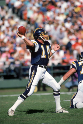 SAN DIEGO - NOVEMBER 29:  Quarterback Dan Fouts #14 of the San Diego Chargers throws a pass during a game against the Denver Broncos at Jack Murphy Stadium on November 29, 1987 in San Diego, California.  Fouts completed 23 out of 48 passes for 322 yards a