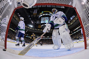 BOSTON, MA - JUNE 13:  Roberto Luongo #1 of the Vancouver Canucks grabs the puck out of the net after a goal scored by Milan Lucic #17 of the Boston Bruins in the first period of Game Six in the 2011 NHL Stanley Cup Final at TD Garden on June 13, 2011 in