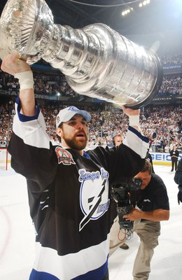 TAMPA, FL - JUNE 7:  Dan Boyle #22 of the Tampa Bay Lightning celebrates the Stanley Cup win against the Calgary Flames on June 7, 2004 at the St. Pete Times Forum in Tampa, Florida. (Photo by Dave Sandford/Getty Images)