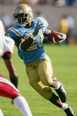 PASADENA, CA - OCTOBER 30:  Maurice Drew #21 of the University of California, at Los Angeles Bruins carries the ball against the Stanford University Cardinal during the game at the Rose Bowl on October 30, 2004 in Pasadena, California. The Bruins won 21-0