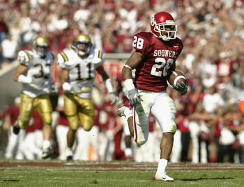 NORMAN, OK - SEPTEMBER 20:  Defensive back Antonio Perkins #28 of the University of Oklahoma Sooners returns a kickoff 84 yards for a touchdown against the University of California, Los Angeles Bruins at Memorial Stadium on September 20, 2003 in Norman, O