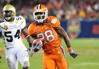 TAMPA, FL - NOVEMBER 28: Running back C. J. Spiller #28 of the Clemson Tigers rushes upfield against the Georgia Tech Yellow Jackets in the 2009 ACC Football Championship Game December 5, 2009 at Raymond James Stadium in Tampa, Florida.  (Photo by Al Mess
