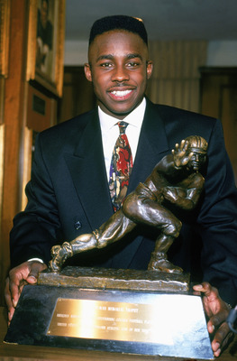 NEW YORK - DECEMBER 14:  Desmond Howard #21 of the Michigan Wolverines poses after being awarded the Heisman Trophy given to the top player in the National Collegiate Athletic Association at the Downtown Athletic Club on December 14, 1991 in New York, New