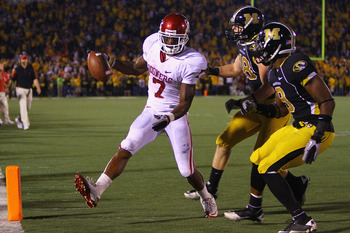 COLUMBIA, MISSOURI - OCTOBER 23: DeMarco Murray #7 of the Oklahoma Sooners scores a touchdown against Marcus Malbrough #18 and Jasper Simmons #9 both of the Missouri Tigers at Faurot Field/Memorial Stadium on October 23, 2010 in Columbia, Missouri.  (Phot