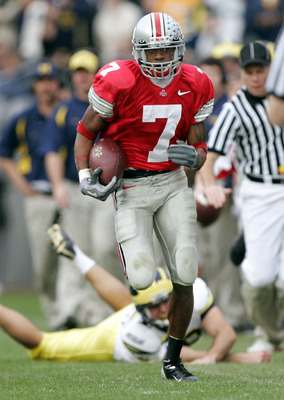 COLUMBUS, OH - NOVEMBER 20:  Defensive back Ted Ginn Jr. #7 of the Ohio State Buckeyes runs past punter Adam Finley #39 of the Michigan Wolverines for an 82-yard touchdown return during the third quarter on November 20, 2004 at Ohio Stadium in Columbus, O