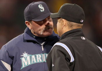 BOSTON, MA - APRIL 30:  Manager Eric Wedge of the Seattle Mariners argues with Todd Tichenor#97 after Miguel Olivo of the Seattle Mariners was called out at first base in the third inning against the Boston Red Sox on April 30, 2011 at Fenway Park in Bost