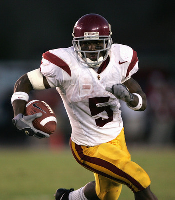 PALO ALTO, CA - SEPTEMBER 25:  Reggie Bush #5 of the USC Trojans carries the ball during the game against the Stanford Cardinal on September 25, 2004 at Stanford Stadium in Palo Alto, California.  USC defeated Stanford 31-28. (Photo by Stephen Dunn/Getty