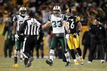 PITTSBURGH, PA - JANUARY 23:  Eric Smith #33 of the New York Jets argues with back judge Dino Paganelli #105 against the Pittsburgh Steelersduring the 2011 AFC Championship game at Heinz Field on January 23, 2011 in Pittsburgh, Pennsylvania.  (Photo by Al