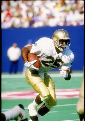 3 Nov 1990:  Flanker Raghib Ismail of the Notre Dame Fighting Irish runs down the field during a game against the Navy Midshipmen at Giants Stadium in East Rutherford, New Jersey.  Notre Dame won the game 52-31. Mandatory Credit: Rick Stewart  /Allsport