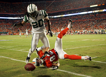 MIAMI - SEPTEMBER 26:  Cornerback Kyle Wilson #20 of the New York Jets is called for pass interference on Receiver Brian Hartline #82 of the Miami Dolphins at Sun Life Stadium on September 26, 2010 in Miami, Florida.  (Photo by Marc Serota/Getty Images)