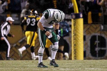 PITTSBURGH, PA - JANUARY 23:  Quarterback Mark Sanchez #6 of the New York Jets walks towards the sideline in pain against the Pittsburgh Steelers during the 2011 AFC Championship game at Heinz Field on January 23, 2011 in Pittsburgh, Pennsylvania. The Ste