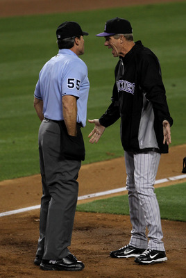LOS ANGELES - MAY 31:  Manager Jim Tracy of the Colorado Rockies argues with home plate umpire Angel Hernandez after Casey Blake of the Los Angeles Dodgers wa called safe on a play at home plate in the third inning on May 31, 2011 at Dodger Stadium in Los