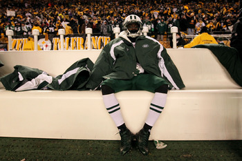 PITTSBURGH, PA - JANUARY 23:  Joe McKnight #25 of the New York Jets sits dejected after being defeated 24 to 19 by the Pittsburgh Steelers in the 2011 AFC Championship game at Heinz Field on January 23, 2011 in Pittsburgh, Pennsylvania.  (Photo by Al Bell