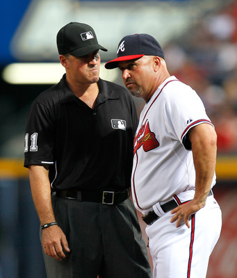 ATLANTA, GA - JUNE 01:  Fredi Gonzalez #33 of the Atlanta Braves and first base umpire Tony Randazzo #11 against the San Diego Padres at Turner Field on June 1, 2011 in Atlanta, Georgia.  (Photo by Kevin C. Cox/Getty Images)
