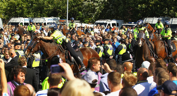 LEEDS, ENGLAND - AUGUST 21:  Police escort the Millwall supporters into the ground ahead of the Npower Championship match between Leeds United and Millwall at Elland Road on August 21, 2010 in Leeds, England.  (Photo by Matthew Lewis/Getty Images)