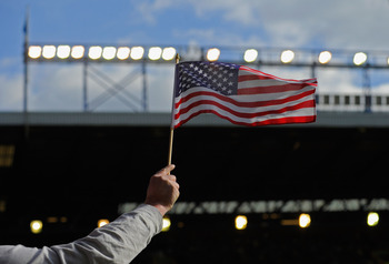 LIVERPOOL, ENGLAND - OCTOBER 17: An Everton fan waves an American flag during the Barclays Premier League match between Everton and Liverpool at Goodison Park on October 17, 2010 in Liverpool, England.  (Photo by Michael Regan/Getty Images)