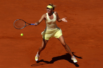 PARIS, FRANCE - JUNE 02:  Maria Sharapova of Russia hits a forehand during the women's singles semi final match between Na Li of China and Maria Sharapova of Russia on day twelve of the French Open at Roland Garros on June 2, 2011 in Paris, France.  (Phot