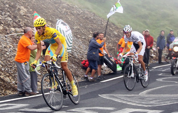 COL DU TOURMALET, FRANCE - JULY 22:  Alberto Contador of Spain and the Astana Team leads Andy Schleck of Luxembourg and Team Saxo Bank as he attacks up the slopes of the Col du Tourmalet during stage seventeen of the 2010 Tour de France from Pau to Col du