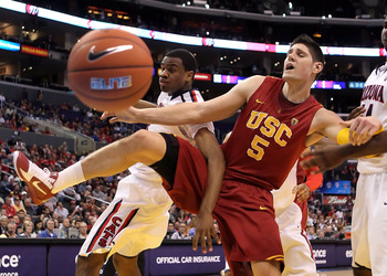 LOS ANGELES, CA - MARCH 11:  Kevin Parrom #3 of the Arizona Wildcats and Nikola Vucevic #5 of the USC Trojans battle for a loose ball in the first half in the semifinals of the 2011 Pacific Life Pac-10 Men's Basketball Tournament at Staples Center on Marc