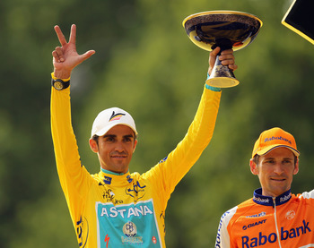 PARIS - JULY 25:  Alberto Contador of team Astana (L) celebrates on the podium after the twentieth and final stage of Le Tour de France 2010, from Longjumeau to the Champs-Elysees in Paris on July 25, 2010 in Paris, France.  (Photo by Spencer Platt/Getty