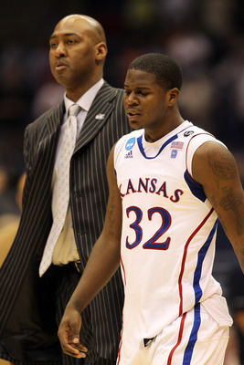 SAN ANTONIO, TX - MARCH 27:  Josh Selby #32 of the Kansas Jayhawks and assistant coach Danny Manning react after the southwest regional final of the 2011 NCAA men's basketball tournament against the Virginia Commonwealth Rams at the Alamodome on March 27,
