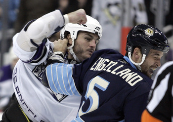 PITTSBURGH, PA - FEBRUARY 10:  Kevin Westgarth #19 of the Los Angeles Kings mixes it up with Deryk Engelland #5 of the Pittsburgh Penguins at Consol Energy Center on February 10, 2011 in Pittsburgh, Pennsylvania.  (Photo by Justin K. Aller/Getty Images)