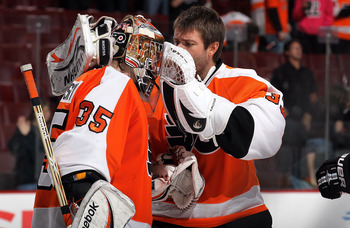 PHILADELPHIA - OCTOBER 26:  Sergei Bobrovsky #35 of the Philadelphia Flyers celebrates with teammate  #33 after defeating the Buffalo Sabres on October 26, 2010 at Wells Fargo Center in Philadelphia, Pennsylvania. The Flyers defeated the Sabres 6-3.  (Pho