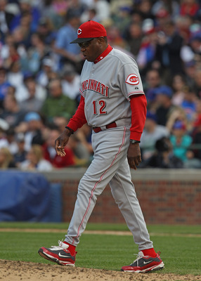 CHICAGO, IL - MAY 06: Manager Dusty Baker #12 of the Cincinnati Reds walks to the mound to make a pitching change against the Chicago Cubs at Wrigley Field on May 6, 2011 in Chicago, Illinois. The Reds defeated the Cubs 5-4. (Photo by Jonathan Daniel/Gett