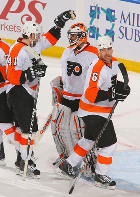 BUFFALO, NY - APRIL 18: Andrej Mezaros #41 and Sean O'Donnell #6 of the Philadelphia Flyers congratulate Brian Boucher  #33 after defeating the Buffalo Sabres  4-2 in Game Three of the Eastern Conference Quarterfinals during the 2011 NHL Stanley Cup Playo