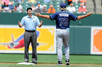 BALTIMORE, MD - JUNE 12:  Manager Joe Maddon #70 of the Tampa Bay Rays argues with second base umpire Jim Reynolds during the second inning of the game against the Baltimore Orioles at Oriole Park at Camden Yards on June 12, 2011 in Baltimore, Maryland.