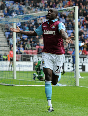 WIGAN, ENGLAND - MAY 15:  Demba Ba of West Ham United celebrates scoring the openng goal during the Barclays Premier League match between Wigan Athletic and West Ham United at the DW Stadium on May 15, 2011 in Wigan, England.  (Photo by Chris Brunskill/Ge