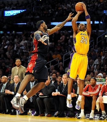 LOS ANGELES, CA - JANUARY 19:  Kobe Bryant #24 of the Los Angeles Lakers shoots a jumper against LeBron James #23 of the Cleveland Cavaliers during the game at Staples Center on January 19, 2009 in Los Angeles, California.  The Lakers defeated the Cavalie