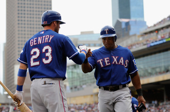 MINNEAPOLIS, MN - JUNE 12: Craig Gentry #23 and Adrian Beltre #29 of the Texas Rangers celebrate Beltre scoring against the Minnesota Twins during the eighth inning of their game on June 12, 2011 at Target Field in Minneapolis, Minnesota. Twins defeated t