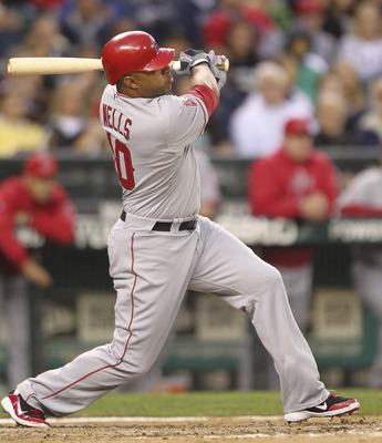 SEATTLE - JUNE 13:  Vernon Wells #10 of the Los Angeles Angels of Anaheim hits a two-run homer in the seventh inning against the Seattle Mariners at Safeco Field on June 13, 2011 in Seattle, Washington. (Photo by Otto Greule Jr/Getty Images)