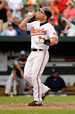BALTIMORE, MD - JUNE 12:  Luke Scott #30 of the Baltimore Orioles celebrates after hitting a home run in the eighth inning against the Tampa Bay Rays at Oriole Park at Camden Yards on June 12, 2011 in Baltimore, Maryland.  (Photo by Greg Fiume/Getty Image