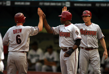 MIAMI GARDENS, FL - JUNE 13: (L-R) Stephen drew #6, Justin Upton #10 and Kelly Johnson #2 of the Arizona Diamondbacks celebrate scoring against the Florida Marlins at Sun Life Stadium on June 13, 2011 in Miami Gardens, Florida.  (Photo by Marc Serota/Gett