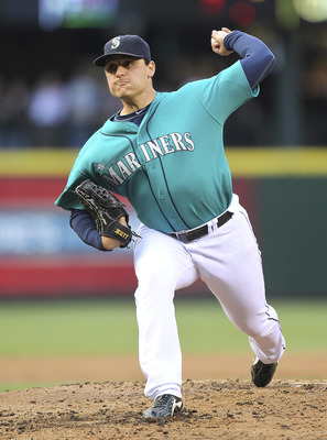 SEATTLE - JUNE 13:  Starting pitcher Jason Vargas #38 of the Seattle Mariners pitches against the Los Angeles Angels of Anaheim at Safeco Field on June 13, 2011 in Seattle, Washington. (Photo by Otto Greule Jr/Getty Images)