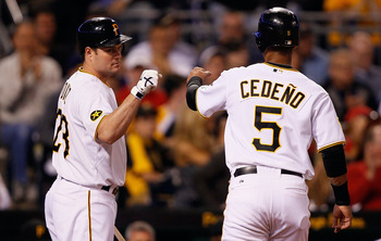 PITTSBURGH - JUNE 13:  Ronny Cedeno #5 of the Pittsburgh Pirates is congratulated by teammate Matt Diaz #23 after walking in a run against the New York Mets in the 8th inning during the game on June 13, 2011 at PNC Park in Pittsburgh, Pennsylvania.  (Phot