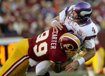 LANDOVER, MD - NOVEMBER 28:  Brett Favre #4 of the Minnesota Vikings is hit by Washington Redskins linebacker Andre Carter #99 at FedExField November 28, 2010 in Landover, Maryland. The Vikings won the game 17-13.  (Photo by Win McNamee/Getty Images)