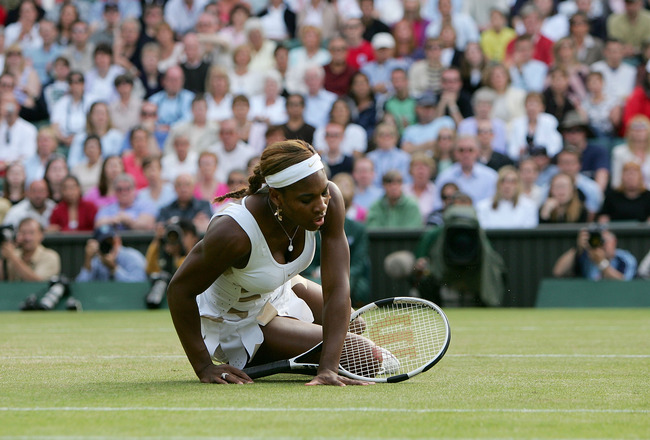LONDON - JULY 1:  Serena Williams of USA falls down during her semi final match against Amelie Mauresmo of France at the Wimbledon Lawn Tennis Championship on July 1, 2004 at the All England Lawn Tennis and Croquet Club in London.(Photo by Mike Hewitt/Get