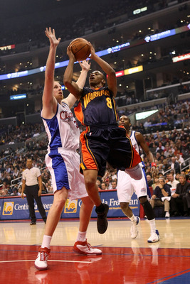 LOS ANGELES, CA - NOVEMBER 02:  Monta Ellis #8 of the Golden State Warriors goes up for a shot over Chris Kaman #35 of the Los Angeles Clippers during a game on November 2, 2007 at Staples Center in Los Angeles, California.  NOTE TO USER: User expressly a