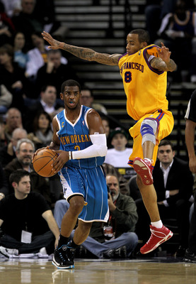 OAKLAND, CA - JANUARY 27:  Chris Paul #3 of the New Orleans Hornets is guarded by Monta Ellis #8 of the Golden State Warriors at Oracle Arena on January 27, 2010 in Oakland, California.  NOTE TO USER: User expressly acknowledges and agrees that, by downlo