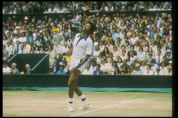 Jul 1975:  Arthur Ashe looks dejected during a match against Jimmy Connors at the Wimbledon Open in Great Britain. Mandatory Credit: Allsport  /Allsport