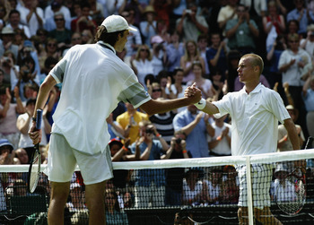 LONDON - JUNE 23:  Ivo Karlovic of Croatia shakes hands at the net after beating defending champion Lleyton Hewitt of Australia during the opening day of the Wimbledon Lawn Tennis Championships held on June 23, 2003 at the All England Lawn Tennis and Croq