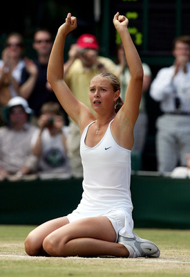 LONDON - JULY 3:  Maria Sharapova of Russia celebrating winning the ladies final match against Serena Williams of USA at the Wimbledon Lawn Tennis Championship on July 3, 2004 at the All England Lawn Tennis and Croquet Club in London. Sharapova won 6-1 6-