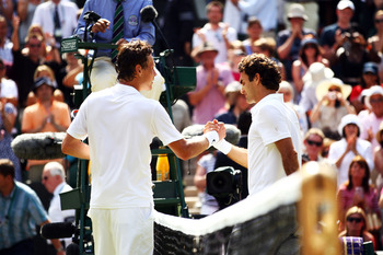 LONDON, ENGLAND - JUNE 30:  Tomas Berdych of Czech Republic (L) shakes hands after winning his Quarter Final match against Roger Federer of Switzerland on Day Nine of the Wimbledon Lawn Tennis Championships at the All England Lawn Tennis and Croquet Club