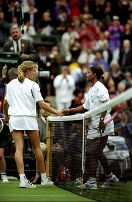 Jun-Jul 1994:  Steffi Graf of Germany shakes hands with Lori McNeil of the USA after their match during the Wimbledon Championships held at the All England Club in Wimbledon, England.  Lori McNeil won the match. \ Mandatory Credit: Bob  Martin/Allsport